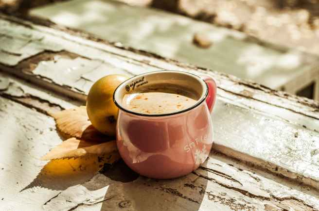 brown liquid on pink ceramic mug