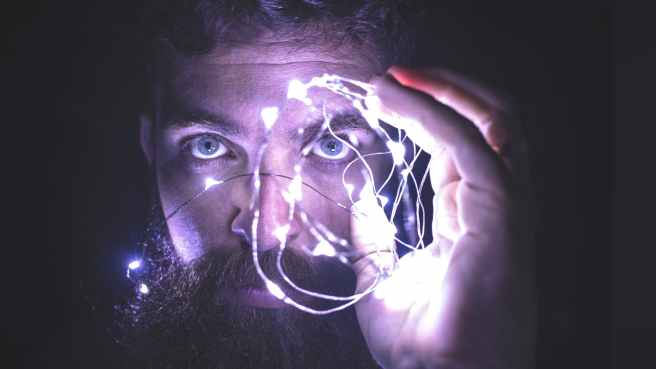person holding string lights photo